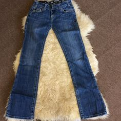 Rock and roll cowgirl jeans 26x34 I love these, but they are too small for me. Never worn, and in perfect condition. Jeans