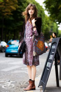 boho street style look: velvet dress, tunic dress, printed bag, and flat ankle boots