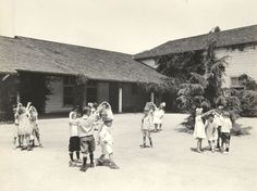 Dancing on the playground at Pasadena Polytechnic Elementary School, 1920.F.W. Martin, photographer.