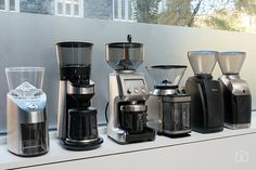 The electric grinder contestants from L-R: Capresso Infinity, OXO On, Breville Smart Grinder Pro, Cuisinart DBM-8, Baratza Encore, Baratza Virtuoso. (Not pictured: Mahlkönig EK43, because we had to grind that at Counter Culture's training facility.) Photo: Amadou Diallou
