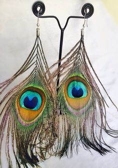Peacock Feather Earrings  For price enquiry email @ hello@thebollywoodbazaar.com