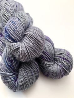 A personal favorite from my Etsy shop https://www.etsy.com/ca/listing/496856938/hand-dyed-yarn-grey-blue-violet