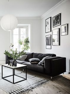 Living room in black, white and gray with nice Gallery wall.