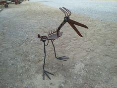 Recycled metal yard art by Nate Hook