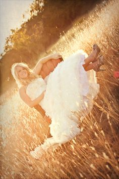 Totally want a pic like this on my wedding day......w cowgirl boots<3