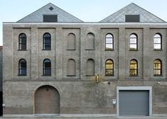 Archipl-Architects converts former washing machine factory into a light-filled workplace.