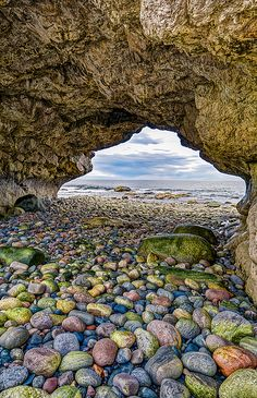 The Arches Provincial Park, Newfoundland, Canada. Ancient limestone carved by eons of pounding surf have created the Arches, a natural rock formation known throughout the province. The site, located just north of Parsons Pond, contains picnic tables and a parking area, along with a trail leading to the huge rocks. You can walk under the Arches or on top of them and feel the awesome strength of the sea. Gord Follett Photography