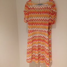Colorful dress with ruching on sleeves. Shell: 90% polyester 7% acrylic 3% metallic. Please note that although NWT, the price has been removed. NY Collection Dresses