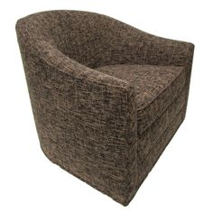 This compact barrel chair by Harvey Probber features a swiveling base and a removable seat cushion.