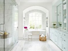 mark williams design- I LOVE the light in this bathroom, it's so open and bright! The Marble tile is amazing.