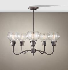 Our Price $401.50 Feiss Lighting – 5-light chandelier in a Rustic Iron finish with antique clear seeded glass. Reg. Price 621.00