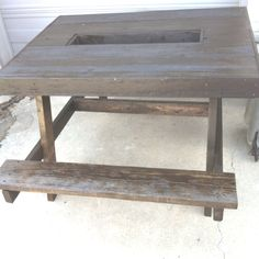 Picnic table with cooler in the middle...all reused wood