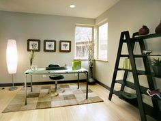 Minimalist Home Office: A glass-topped desk and minimalist accessories make for an uncluttered home office. From HGTVRemodels.com