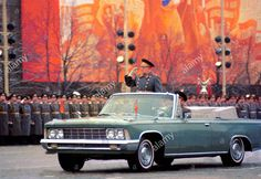 The Defense Minister of the Soviet Union, Marshal Dmitry Ustinov, inspecting the troops on his ZiL-117V limousine at the 1977 Moscow October Revolution Day Parade.
