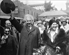 """3 Mar 1931: """"Southern California said good-bye to its most distinguished visitor of the year, when Dr.Albert Einstein, father of the relativity theory departed from Pasadena. With his wife and party the famous scientist will travel to New York in a private car placed at their disposal. Dr. and Mrs.Einstein are here shown waving their farewells to the crowd at the Pasadena Railway Station."""""""