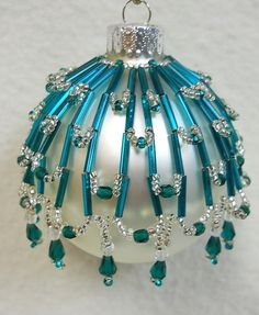 """This cover fits a standard size Glass Ball 2 5/8"""" (not included). Original design from the  House of Whispering Firs  """"Tahoe"""".  This beaded cover is a combination of glass seed, bugle and faceted beads along with faceted drops"""
