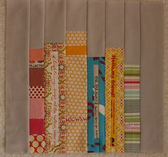 Patchwork Books. LOVE the idea of using sevledges as the spines/ names!