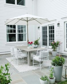 Outdoor patio space | Outdoor table | Gray outdoor table with white chairs | CB2 chairs modern gray outdoor table | Summer outdoor eating #outdoortable  Darlingdarleen.com Long Pipe, Outdoor Tables, Outdoor Decor, Diy Plant Stand, Patio Dining, Modern Chairs, Fall Decor, Outdoor Living, Outdoor Furniture Sets