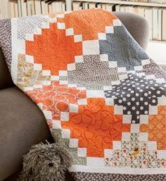 Quilty Magazine shoving a modern quilt. Orange & purple are 2018 Pantone colors of the year