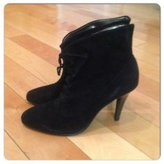 Calvin Klein Sadee Suede Bootie Calvin Klein Sadee Suede ankle boots in black. Lace up closure. Pull on style. Decorative bow detail. Gathered style. Round toe design. Calvin Klein Shoes