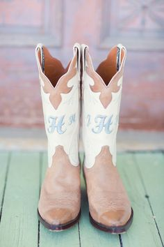 Monogrammed cowboy boots. Barr Mansion Wedding from Half Orange Photography  Read more - http://www.stylemepretty.com/texas-weddings/2013/07/08/barr-mansion-wedding-from-half-orange-photography/