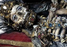 Catacomb saints are ancient Roman corpses that were exhumed from the catacombs of Rome, given fictitious names and sent abroad as relics of saints from the 16th century to the 19th century. They were typically lavishly decorated with gold and precious stones.