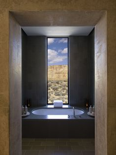 Vertical tiles and an amazing view from the bathroom of a Mesa View Suite at Amangiri in Canyon Point, Southern Utah