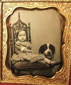 Vintage photo -- girl in ornate chair with dog.