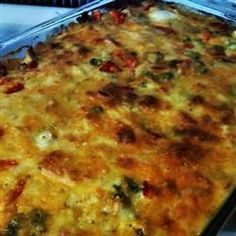 Make-Ahead Breakfast Casserole Recipe Breakfast and Brunch with seasoned croutons, spicy pork sausage, eggs, milk, condensed cream of mushroom soup, frozen chopped spinach, mushrooms, shredded sharp cheddar cheese, shredded Monterey Jack cheese, dry mustard, fresh parsley
