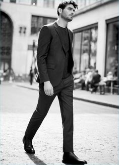 The suit receives a dark green update with Reiss' slim-fit wool blazer $520 and trousers $240.