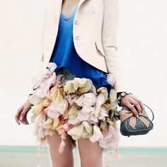 bunches of fabric flowers and the cutest bow clutch.