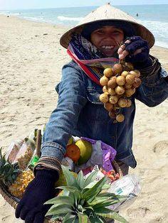 Lanzones anyone? Fruit vendor on Cua Dai Beach near Hoi An, Vietnam.