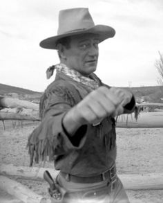 "He and his drinking buddy, actor Ward Bond, frequently played practical jokes on each other. In one incident, Bond bet Wayne that they could stand on opposite sides of a newspaper and Wayne wouldn't be able to hit him. Bond set a sheet of newspaper down in a doorway, Wayne stood on one end, and Bond slammed the door in his face, shouting ""Try and hit me now!"" Wayne responded by sending his fist through the door, flooring Bond (and winning the bet)."
