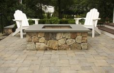 Square fire pits, like this one with fieldstone and bluestone cap, provide more gathering space for friends.
