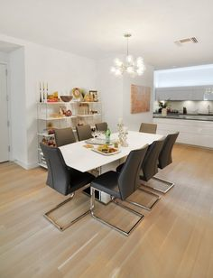 This kitchen dining area is slick, elegant, modern and somehow very romantic.