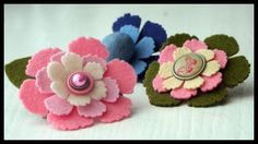 Beautiful felt hair barretts or scrapbook page embellishments made using Spellbinders flower die templates. I can see doing this!