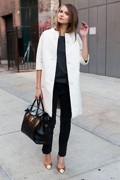 White coat with black and bicolor pumps.