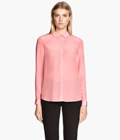Silk blouse in soft colors. This one counts as a basic.