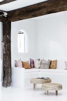 Faded shades of terra-cotta, plum, and rose add warmth to the otherwise white space.