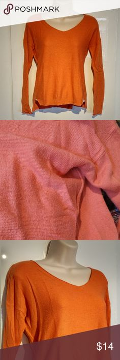 Mossimo Light Coral Sweater XS Super comfy and lightweight Mossimo Supply sweater color CORAL (pinky-peachy-orangy) (NOT orange as shown in most pictures... my camera didn't pick up the color correctly - second picture is most representative of color or see last picture for fashion inspiration) in size XS. Feel free to make me an offer or bundle with other items in my closet to save $$! Thanks for looking =) Mossimo Supply Co. Sweaters