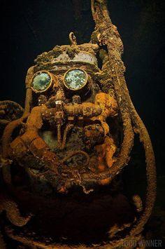 Fujikawa Maru mask underwater in Truk Lagoon, Chuuk Titanic Underwater, Underwater Shipwreck, Underwater Life, Underwater Photos, Underwater Photography, Film Photography, Street Photography, Underwater Tattoo, Landscape Photography