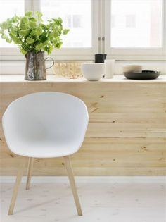Lotta Agaton - Stylist - simple light wood and white with a small pop of green from the beautiful flowers. Perfection.