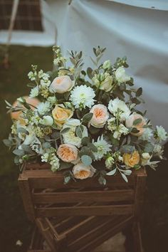 Larger arrangement on stacked crates at entrance to marquee or at the end of aisle. florals; love blooms.co.uk, photography; http://www.modernvintageweddings.com