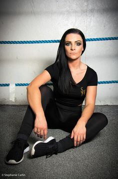 Model wears S.H crop tee shirt with black S.H embroidered exercise leggings.