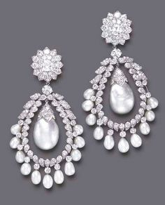 A PAIR OF DIAMOND AND CULTURED PEARL EAR PENDANTS, BY DAVID WEBB  Each circular-cut diamond cluster surmount, centering upon an old mine-cut diamond, suspending a circular-cut diamond hoop, with circular-cut diamond and drop-shaped cultured pearl fringe, centering upon a detachable independent drop-shaped baroque cultured pearl, measuring approximately 21.40 x 13.40 mm, with an old European-cut diamond cap, mounted in platinum, (one baroque cultured pearl deficient), circa 1960