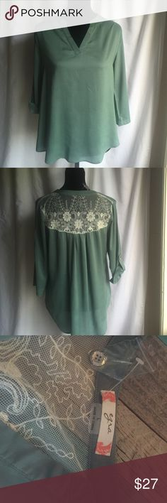 Green Blouse with Back Lace Panel Green Ezra Blouse with back lace panel. Sleeves can be rolled up and buttoned or worn as 3/4 length. Tops Blouses