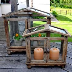 I think I could make a small terrarium like these out of cheap picture frames and just weather them a bit and add hinges and legs.