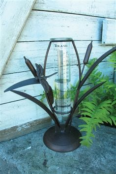 #Cattail Tabletop Rain Gauge.  As a gardener Rain Gauges are a great way to keep track of how much water your plants are getting to ensure you don't over-water them. Our line of decorative rain gauges provide both the functionality you need and an attractive form to spruce up your yard. #raingauge