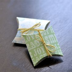 Using scrapbook paper, make your own little pillow boxes!