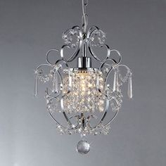 This petite chandelier features rows and strings of cascading crystals. The light from its single bulb scatters into many bits of breathtaking light that make it appears it has multiple light sources. Warehouse of Tiffany Jess Crystal Chandelier Tiffany Chandelier, Chandelier Ceiling Lights, Pendant Lighting, Pendant Chandelier, Ceiling Decor, Closet Chandelier, Simple Chandelier, Country Chandelier, Round Chandelier